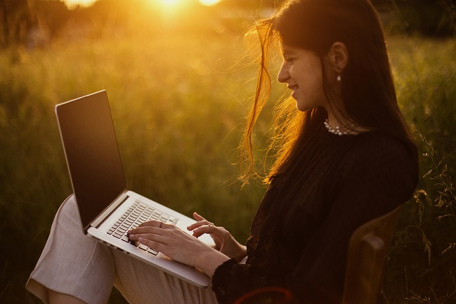 Freelance and remote work outdoors. Young business woman working